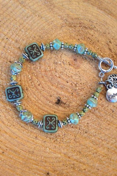 7 3/4' Czech bead bracelet with 'kindness' and heart charm